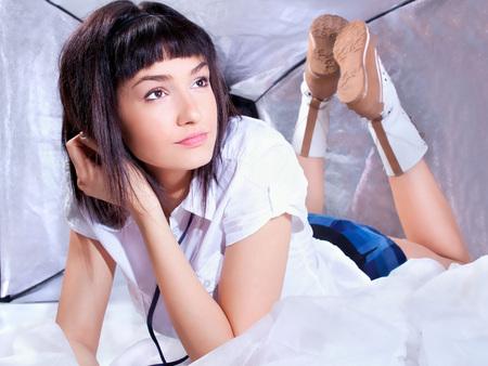 Beautiful young  brunette in white shirt  posing , studio shot