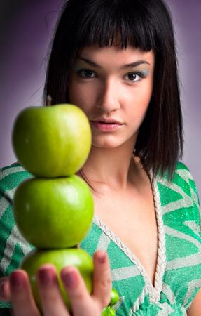 beautiful young woman with fresh apple, studio shot Standard-Bild - 120897604