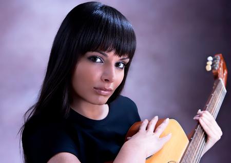 Beautiful Woman are Playing Guitar, studio shot