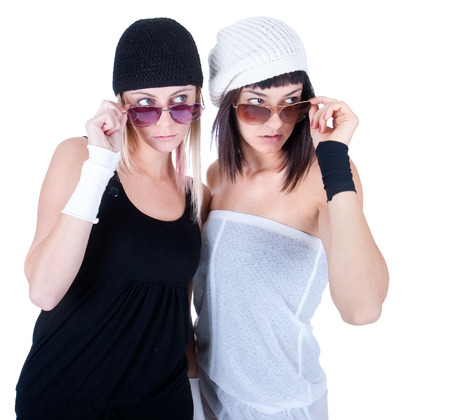 Two young pretty Women stare at some other, isolated on white Banco de Imagens - 120897687
