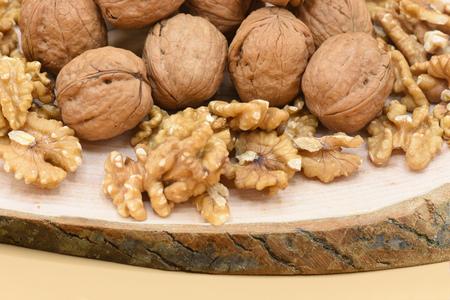 Walnut on wooden floor