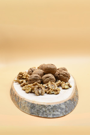 walnut on wooden billet Stok Fotoğraf - 100578069