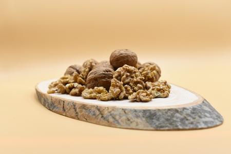 walnut on wooden billet Stok Fotoğraf - 100587021