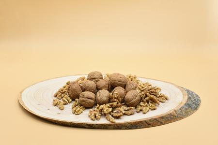 walnut on wooden billet Stok Fotoğraf - 100534098