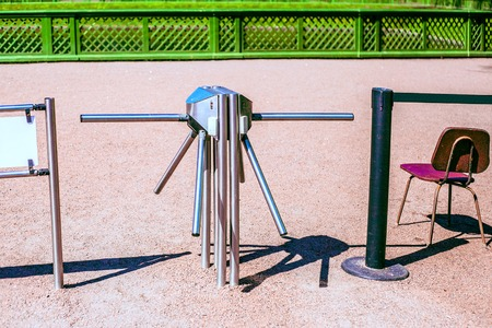 Turnstile and chair outdoors