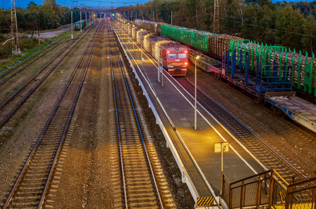 Electric train at the station at night Stock Photo