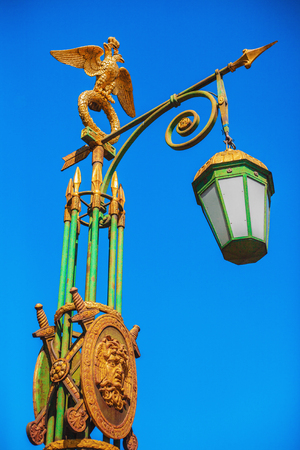 gilt head: Streetlight with a gilded two-headed eagle in St. Petersburg, Russia
