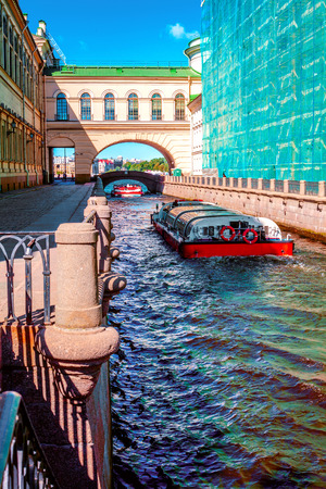 Pleasure boat floats on the Winter Canal in St. Petersburg