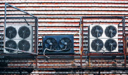 Electric industrial fan on the wall Stock Photo