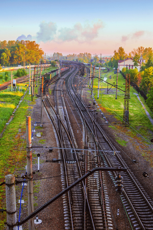 Landscape with a view of the twisted branches of the railway in the early morning