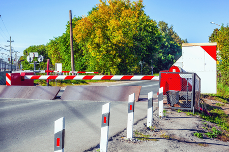 The barrier on the road and Arrangement of railroad crossing fence 写真素材