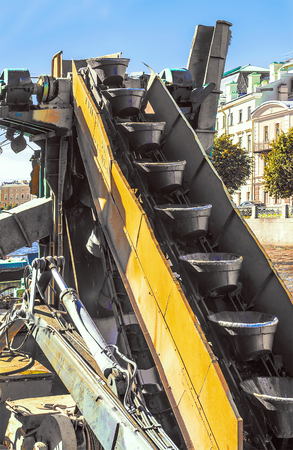 Conveyor endless chain of buckets - the digging element on bucket dredger excavator