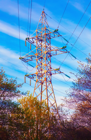 High-voltage power line pylon and line cables. Power transmission line in sunny day. Electrotechnical industry