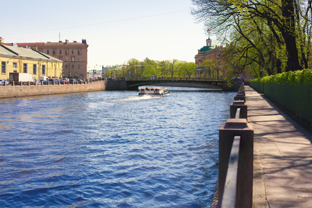 View of the Fontanka river, granite embankment, Panteleimonovsky bridge and Mikhailovsky castle in St. Petersburg Stock Photo