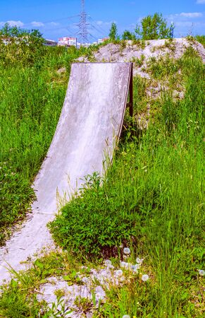 Abrupt springboard on a velodrome in grass thickets