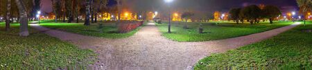 Fork of three roads at night. The choice of path in the Park suburb. 스톡 콘텐츠