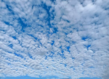 Beautiful background of white cloud cover on blue sky