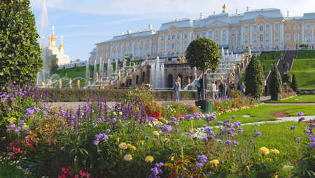 ST. PETERSBURG, RUSSIA - September 2, 2020: Peterhof reopened its parks after quarantine. Few in numbe tourists visit the fountains of the Great Cascade.
