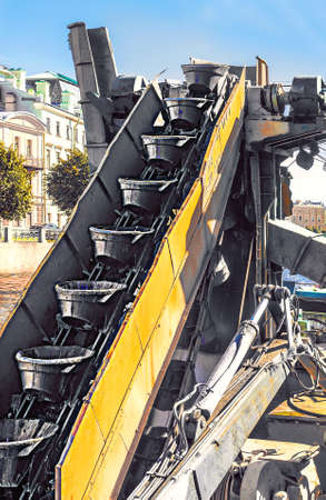 Buckets on a revolving chain to remove large quantities of material, located on the bucket chain excavator (BCE) is a piece of heavy equipment used in surface mining and dredging. 版權商用圖片
