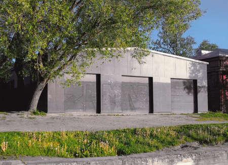 Black hangar structure with three closed doorways 版權商用圖片