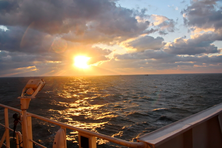 Sunset in the Pacific Ocean. Different types of sunset from the side of the ship while driving and anchoring at the port. Riot of colors of the ocean, clouds and sun.