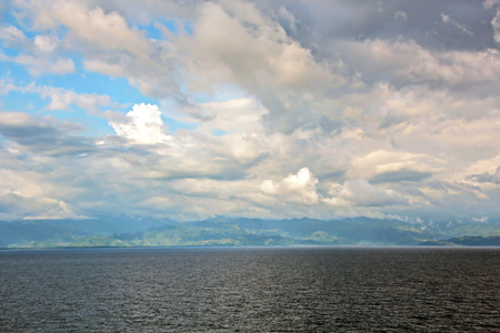 Seascapes. Various kinds of colorful blue sky, sun, clouds and open spaces of the world ocean. View from the side of the sea ship while moving and in the port at anchor. Archivio Fotografico