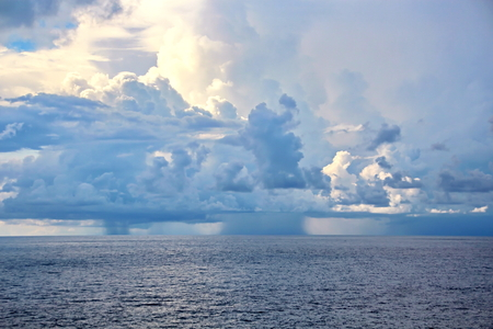 Seascapes. Various kinds of colorful blue sky, sun, clouds and open spaces of the world ocean. View from the side of the sea ship while moving and in the port at anchor. Stock Photo
