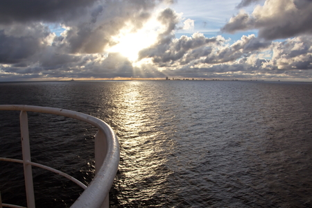 Panoramic views of the coast of the city of Brownsville, USA in the daytime and in the evening in the red rays of sunset. June, 2018. Observation from the side of the vessel in the roadstead.