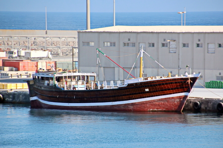Type of port berths with moored vessels. Port of Salalah, Oman.