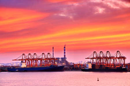 Panoramic night views of piers, sea vessels, tugboats and the city of Rizhao, China. Stock Photo