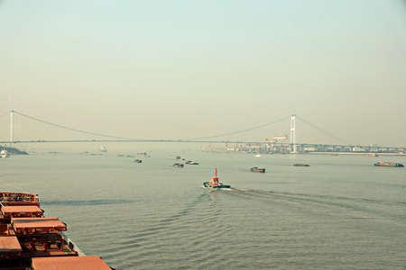 The movement of river and sea transport along the Yangtze River. Jiangyin. China Stock fotó