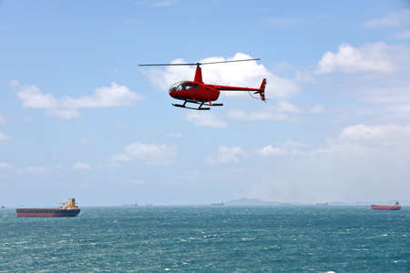 A helicopter used to receive a pilot on a sea vessel. Gladstone QLD, Australia