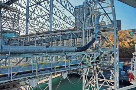 Cargo terminal for loading grain cargo by shore cranes. Port Tacoma, WA, USA. October, 2019.