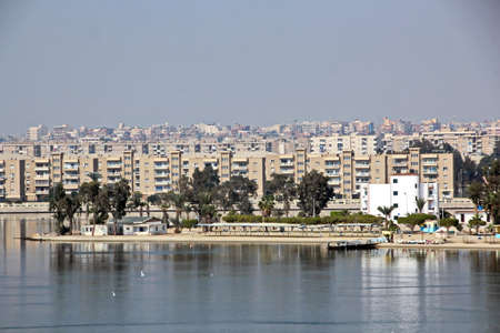 Passage through the Suez Canal by large sea vessels.Panoramic view of the coast and canal in the bays of Suez.
