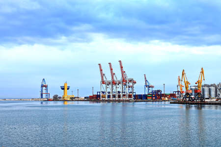Port of Odessa, Ukraine, March, 06, 2020. Views of container and cargo berths with sea vessels, tugs and yachts in the port.