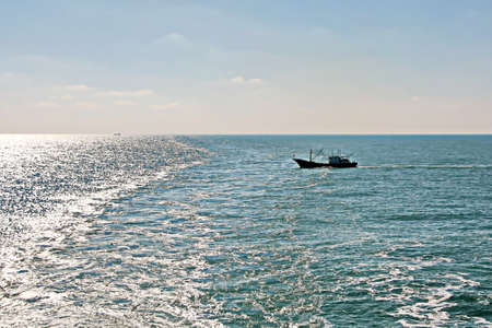 Fishing boats engaged in fishing in the South China Sea. Archivio Fotografico