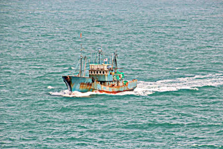 Fishing boats engaged in fishing in the South China Sea.