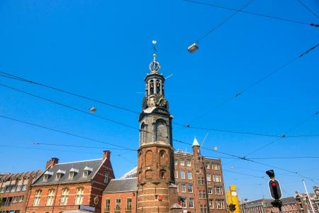 dam square: Amsterdam, Tram and Church near Dam Square Stock Photo