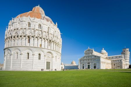 miracle square: Pisa, Piazza dei miracoli, with the Basilica and the leaning tower. Shot with polarizer filter.