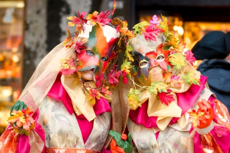 Two golden mask in Venice, Italy  photo