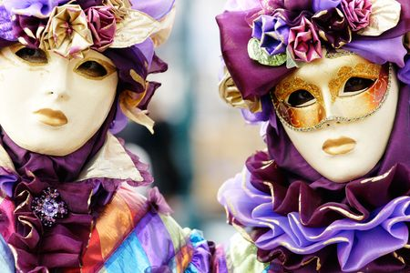 Portrait of two Beautiful masks in Venice, Italy.
