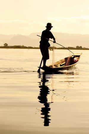 Silhouette of Fisherman in inle lake, Myanmar. Stock Photo - 6222683