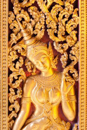 apsara: Golden Apsara carbved on a door, Luang prabang, laos.