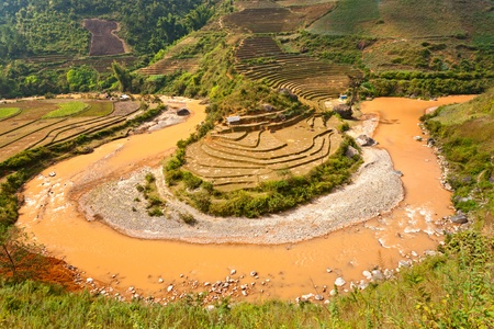 bali province: Panoramic view of Rice terrace field and river in North Vietnam. Stock Photo
