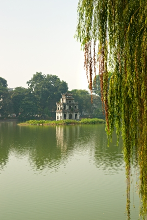 the long lake: Ho Hoan Kiem, the little lake in the old part of Hanoi, Vietnam, with the Tortoise Tower  Tortoise Tower is the symbol of Hanoi,Vietnam