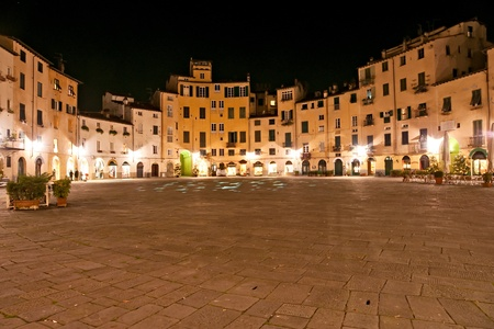 lucca: Lucca - view of StLucca - Piazza Anfiteatro at night. Tuscany, italy. Martins Cathedral