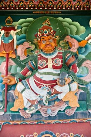 trone: Buddha inside a Nepalese Temple in Bodhgaya, Bihar, India.
