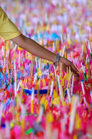 Hand with Candles in Loi Kratonf festival, bangkok. Stock Photo - 8954359