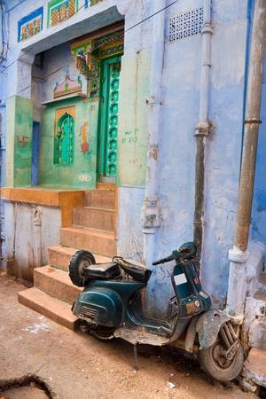Indian street, motorbike and colored door. photo
