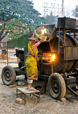 hard work: Woman working on the street, India.